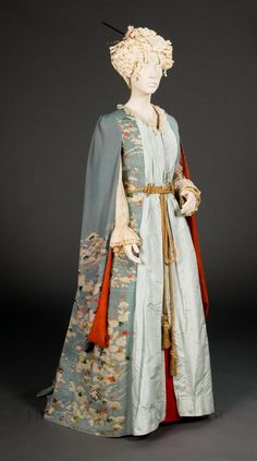 Beginning in the late 19th century, Asian decorative arts, had a tremendous impact on Western culture. Through the addition of princess seams, lace undersleeves and inserts of pale-blue taffeta at front and back, the furisode kimono became a stylish Western dressing gown, complete with bustle. Regardless of these Western elements, the dressing gown is strongly evocative of Japan, particularly in its retention of the crimson lining often found in women's kimonos.