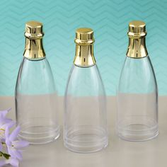 Perfectly Plain Collection Champagne Bottle Acrylic Container with Gold Foil Top- Champagne captures the essence of celebration and these clear acrylic champagne bottles will delight your guests when filled with thoughtful treats!