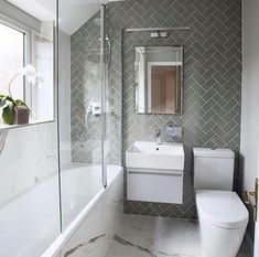 Small bathroom does not have to be boring. One of my favorite bathroom projects! … Small bathroom doesn't need to be boring. One of my favourite bathroom projects! Love the combination of herringbone and marble effect tiles in this bathroom, which togethe Gray And White Bathroom, Bathroom Interior Design, Modern Bathroom Design, Bathroom Makeover, Shower Room, Bathroom Renovations, Bathroom Design Small, Luxury Bathroom, Bathroom Renovation