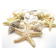 Pulseira Tesouros do Mar Brinde = uma linda joia em prata, nas compras acima de R$ 200,00, na Leona Secrets