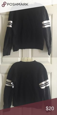 Black and White Sweatshirt Really cool sweatshirt with white stripes around the arms. Super comfortable and warm. Tops Sweatshirts & Hoodies
