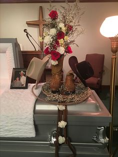 Casket flower arrangement for my dad. #funeral #family #rope #cowboy #dad #boots #flowers #western #country