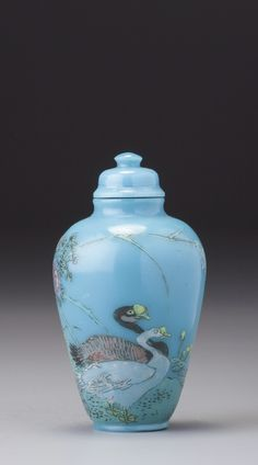 AN ENAMELLED TURQUOISE-BLUE GLASS 'GEESE' SNUFF BOTTLE YANGZHOU SCHOOL, SEAL MARK AND PERIOD OF QIANLONG
