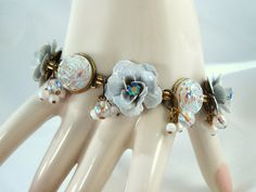 Bridal Jewelry Bracelet Enamel White Roses Vintage Cabochons, Beads, Rhinestone. $35.00, via Etsy.