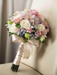 Stunning cream roses, pink mini carnations, pink alstroemeria, pink double lisianthus, blue hydrangea and bupleurum are brought together to create a picture-perfect bouquet. Tied together with a soft peach satin ribbon accented with pixie pearl pins Ribbon Bouquet, Bridal Bouquet Pink, Bridal Flowers, Wedding Bouquets, Silk Flower Bouquets, Mini Carnations, Wedding Venues, Wedding Day, Trendy Wedding