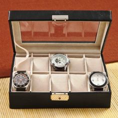 This black top-stitched leather watch case has a glass hinged lid and is a great way to showcase and protect his watches. 10 khaki suede-like removable velvet watch cushions providing plenty of room f