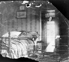 Room in Petersen House where President Lincoln died, photo by Julius Ulke, April 15, 1865