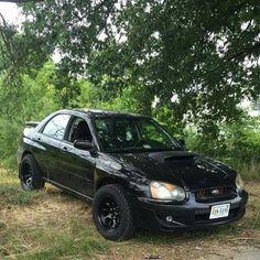 jacked Subaru Impreza WRX