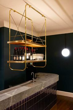 IGNORE THE FUG DESIGN - I like this concept. Could you suspend a more modest version of this above the bar, then have a clearer surface for the wash station etc? Bar Interior, Restaurant Interior Design, Suspended Shelves, Bar Counter Design, Bar Shelves, Shelving Racks, Shelving Design, Hotel Architecture, Hanging Bar