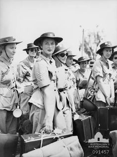 AWAS who arrived in Lae from Australia wait for the trucks to transport them to the AWAS barracks at Butibum Road, New Guinea, 1945