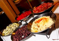 Tapas station -- roasted peppers and artichokes and hummus