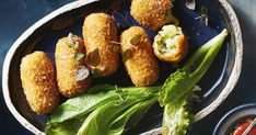 Please a crowd with these golden, cheesy croquettes served with tomato relish and fresh salad leaves.