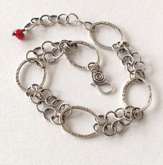 This is a unique handmade fine silver chain bracelet. Each link in this exquisite bracelet has been hand formed and fused by me in my Oregon studio. A dainty and light weight bracelet. This bracelet m