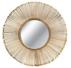 Antique brass-finished metal rods reinterpret a sun mirror from Made Goods.