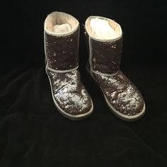 UGG Champagne sparkle boots size 7. Gorgeous boots. Retail $189. Hubby crushed original box so I thru it away already. Replacement box included. Hate to see these go but simply aren't wearing them. UGG Shoes Winter & Rain Boots