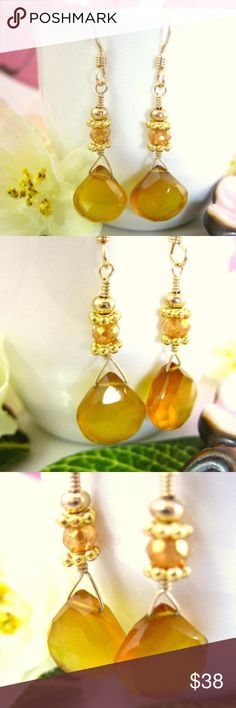 Victorian yellow chalcedony gold drop earrings This is a beautiful pair of Victorian yellow chalcedony gold drop earrings. These earrings are made with rare yellow chalcedony heart briolettes with a hint of brown. The yellow chalcedony are approximately 10x11 mm. The yellow chalcedony is connected to the earring with a 2 gold daisy beads and a yellow mystic quartz rondelles. I delicately hand wire wrapped these earrings together with gold filled wire. The earrings dangle at about 25 mm…