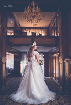 Bride and chandeliers