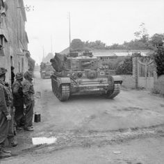 Cromwell tanks of 2nd Northamptonshire Yeomanry, 11th Armoured Division, passing through Herouvillette, 14 June 1944