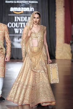 be a golden goddess in this Bridal lehenga by Rimple and Hapreet Narula #indianwedding #shaadibazaar