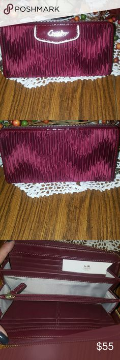 Coach Wallet- Ashley Signature NWOT- Beautiful Coach wallet from the Ashley Signature w- gathered satin design.  BEAUTIFUL VIBRANT COLOR- AS seen in pic#5 that's it's true color,which in my opinion is a deep Cranberry. From a pet & smoke free home. ** Also have matching Purse listed ** Thanks for looking & feel free to stop by my closet anytime as items are added weekly 💖 HAPPY POSHING!!!🌻🌻🌻 Coach Accessories