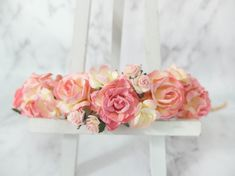 This flower crown features flowers in similar shade which is warm pink. The colors of each flower are all dual tones.  Mulberry paper flowers wire stem
