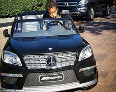Ready to roll:  50 cent's son Sire looked comfortable behind the wheel of his sweet ride.