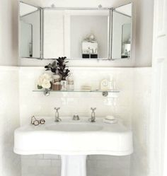 White bathroom, subway tile, vintage sink, vintage mirror shelf from Waterworks owner.