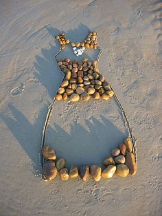 We could write or make something in the sand!!! This pic just gave me the idea !!