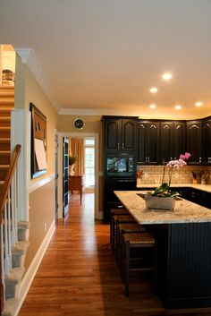 Kitchen renovation- an island like this is what I was talking about hook ... I kinda like the dark cabinets too
