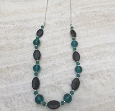 A personal favourite from my Etsy shop https://www.etsy.com/uk/listing/286495335/teal-and-black-long-beaded-necklace