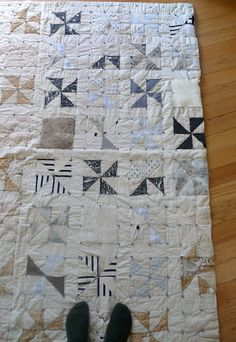 gorgeous quilt that I can see made out of re-cycled men's shirts!
