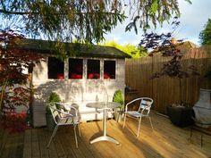 Enthused Monkey: Crafty DIY : Garden Shed Bar Conversion- Very cool idea! Garden Bar, Glass Garden, Diy Garden, Spring Garden, Garden Storage Bench, Storage Sheds, Garden Retaining Wall, Bar Shed, Pub Sheds