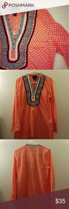 """🎉FLASH SALE🎉Cynthia Rowley Tunic NWOT NWOT Beautiful orange patterned tunic with Navy Blue accented piping around collar and front. Very light weight top with beautiful detail!! From shoulder to bottom hem is 27"""", and across the chest measures 19"""". Sleeves measure 22.5"""". Baggie with extra snaps still attached to tag. Cynthia Rowley Tops Tunics"""
