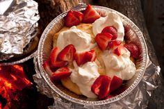 Tired of s'mores? You can make strawberry shortcake a camping reality, thanks to Bisquick mix, whipped cream, and fresh berries.