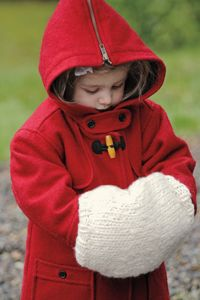 Easily knit and thrum this muff to create a cozy and warm accessory.