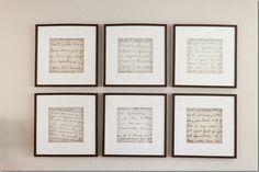 """The artwork above the sofa are old handwritten notes from Sarah's grandmother, mother, and teachers that she has kept all these years.   First, she enlarged the notes on a copier, then she placed them in frames bought from IKEA."""