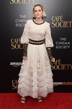 Kristen Stewart in an ivory chiffon and brown leather detailed, ruffled gown and strappy stilettos at the New York premiere of Cafe Society.