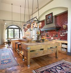 antique butcher block as a kitchen island from TradHome.com. Love this!
