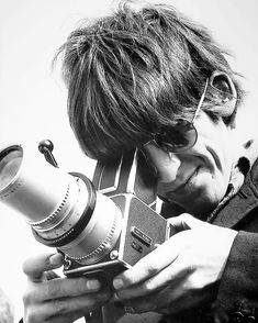 "37.4k Likes, 229 Comments - Rolling Stone (@rollingstone) on Instagram: ""Today would have been George Harrison's 74th birthday. Photographed here with camera in hand, the…"""