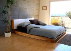 Nice bed. Or may be overall feel to a room with wooden floor and a wide window with a great view