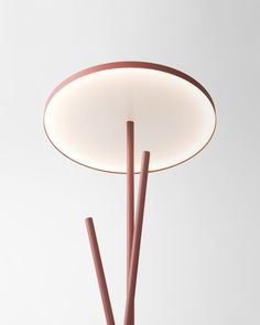 floor lamp with three steel legs and a circular LED lamp