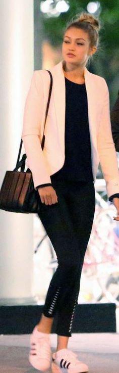Gigi Hadid: Jacket – Smythe  Shoes – Adidas  Purse – Maxmara