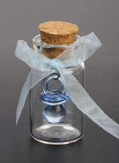 Boy themed baby shower party favor idea - Less than $.25 each  Search Ebay for:   ** Corked Bottles,  ** Blue Pacifier Favor, ** Sheer Blue Ribbon