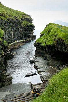 A small bay allows boats to dock in Eysturoy, Faroe Islands