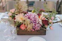 Rustic spring wedding centerpiece in planter