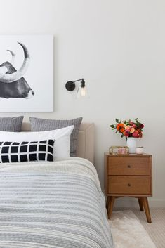 neutral bedroom with large-scale bull art