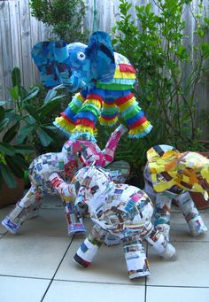 Elephant pinatas getting their party clothes on!