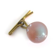 Description A beautiful little saphiret glass button, vibrant in colour. The button is finished with a little metal hook top. Please note the...