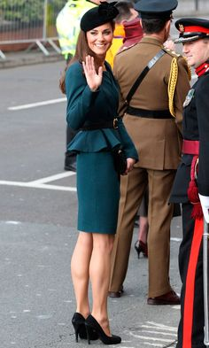 I love that the backs of her heels are worn like a normal woman's! Kate's just like us!