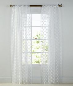 Sweet polka dots in white in combination with the mesh weave is delightfully dotted for a more casual, slightly whimsical look, adding airy softness by Country Curtains.